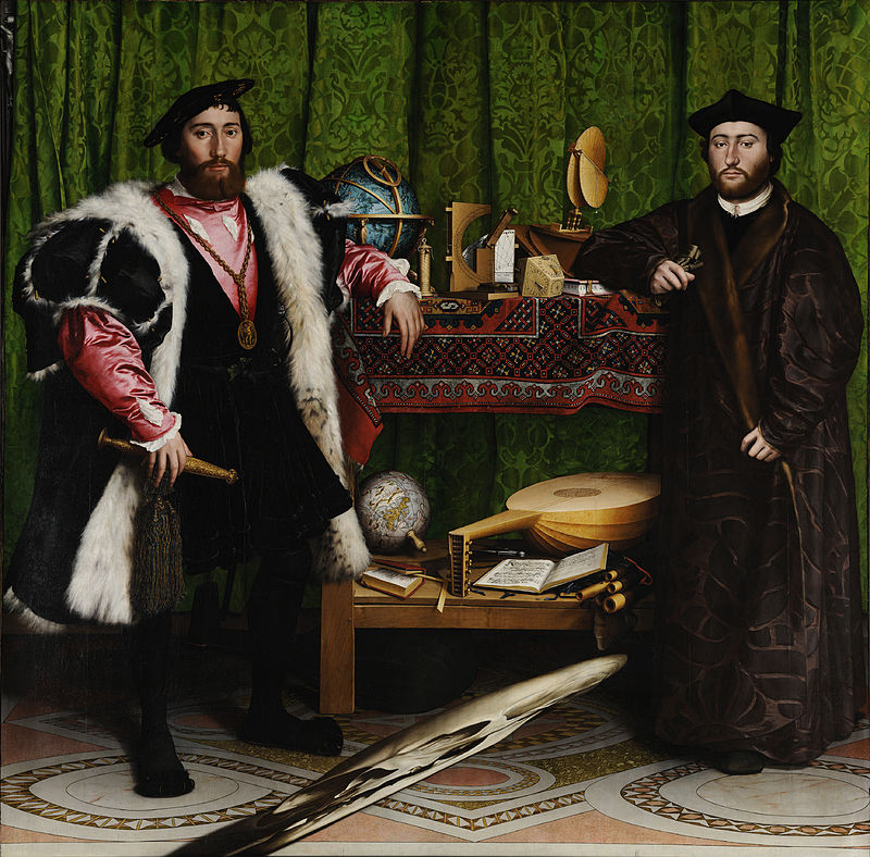 A painting. The subjects are two men in fine dress, whose elbows rest on a table laden with various objects of interest.